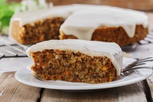 carrot cake with nuts and cream